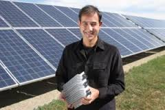 Ampt LLC's chief executive Levent Gun holds one of the Fort Collins-based company's DC power optimizers that reduces the cost of solar installations. Image courtesy Ampt LLC