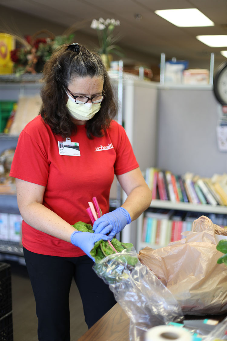 UCHealth Family Medicine Center food pantry fills need for food support logo